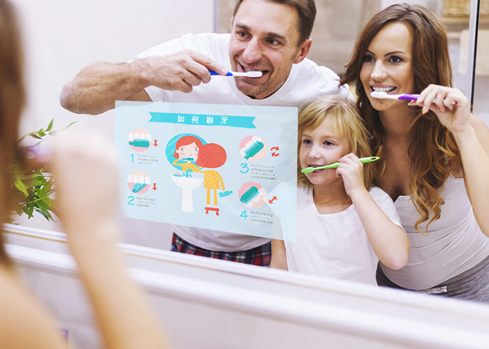 MirrorVue Mirror TV with an image of a family brushing their teeth using a smart mirror TV